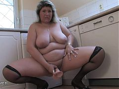 Big mother do dirty things in her kitchen
